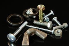 Много винты, болты, шайбы, ногти и гаек стоковая фотография rf