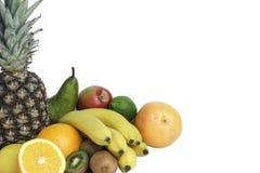 Много зрелые плодоовощи изолированные на белой предпосылке стоковое фото