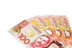 Много из 100 банкнот Новой Зеландии dallar как backgr денег Стоковые Фото