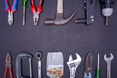Много инструментов на черной предпосылке Стоковая Фотография