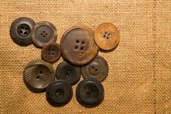 Много кнопки года сбора винограда на старой ткани Стоковое фото RF