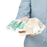 Много, который дуют банкнот евро в руке Стоковая Фотография RF