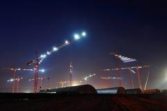 много кранов против неба Стоковая Фотография RF