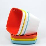 Много красят чашку меламина и поддонник, kitchenware Стоковые Фото