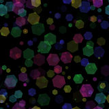 Много красят bokeh шестиугольника на черной предпосылке стоковые фото