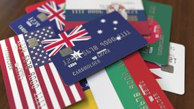 Много кредитных карточек с различными флагами, подчеркнули карту банка с флагом Австралии иллюстрация вектора