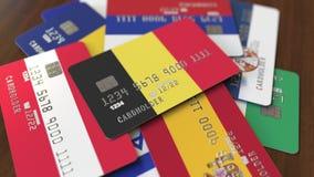 Много кредитных карточек с различными флагами, подчеркнули карту банка с флагом Бельгии иллюстрация штока