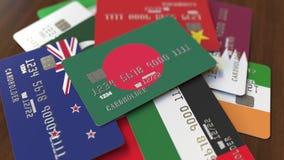 Много кредитных карточек с различными флагами, подчеркнули карту банка с флагом Бангладеша иллюстрация вектора