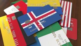 Много кредитных карточек с различными флагами, подчеркнули карту банка с флагом Исландии бесплатная иллюстрация