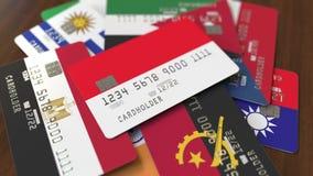 Много кредитных карточек с различными флагами, подчеркнули карту банка с флагом Индонезии иллюстрация штока