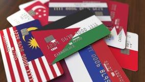 Много кредитных карточек с различными флагами, подчеркнули карту банка с флагом Джордан иллюстрация штока