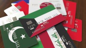 Много кредитных карточек с различными флагами, подчеркнули карту банка с флагом Кувейта иллюстрация штока
