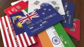 Много кредитных карточек с различными флагами, подчеркнули карту банка с флагом Новой Зеландии иллюстрация вектора