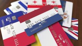 Много кредитных карточек с различными флагами, подчеркнули карту банка с флагом Нидерланд бесплатная иллюстрация