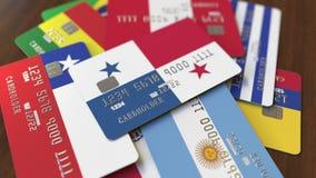 Много кредитных карточек с различными флагами, подчеркнули карту банка с флагом Панамы иллюстрация вектора