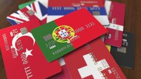 Много кредитных карточек с различными флагами, подчеркнули карту банка с флагом Португалии иллюстрация штока