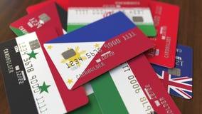 Много кредитных карточек с различными флагами, подчеркнули карту банка с флагом Филиппин бесплатная иллюстрация