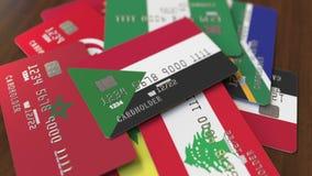 Много кредитных карточек с различными флагами, подчеркнули карту банка с флагом Судана иллюстрация вектора