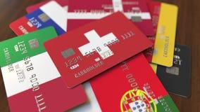 Много кредитных карточек с различными флагами, подчеркнули карту банка с флагом Швейцарии иллюстрация штока