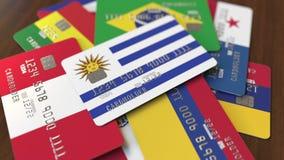 Много кредитных карточек с различными флагами, подчеркнули карту банка с флагом Уругвая иллюстрация вектора