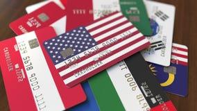 Много кредитных карточек с различными флагами, подчеркнули карту банка с флагом США иллюстрация штока