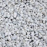 Много круг и овальные камни белого цвета лежат на том основании Стоковое фото RF
