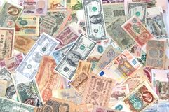 Много монеток, банкноты различных стран и времена деньги Стоковое Фото