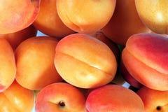 Много оранжевый персик на дне Стоковое фото RF