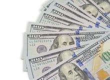 Много 100 долларовых банкнот изолированных на белизне Стоковое Фото