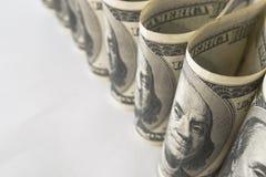 Много долларов США в форме трубок Стоковое Фото