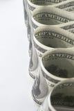 Много долларов США в форме трубок Стоковая Фотография