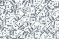 Много долларов штабелированных на белой предпосылке Стоковая Фотография RF