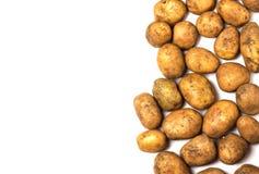 Много пакостные картошки на белой предпосылке Стоковое Изображение