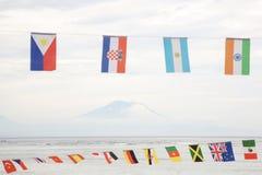 Много различных флагов против неба Стоковая Фотография