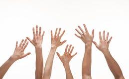 Много рук достигая вне в воздухе Стоковые Изображения