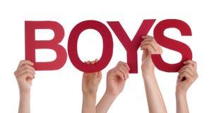 Много рук людей держа красных прямых мальчиков слова Стоковое фото RF