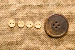 Много старые кнопки на старой ткани Стоковое фото RF