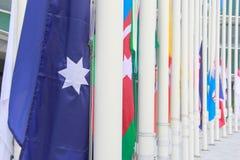 Много флаг подготавливает к верхней части столба Стоковое Фото