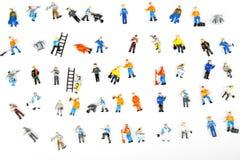 Много figurines работников, женщин людей, на белом backgroud Стоковые Изображения RF