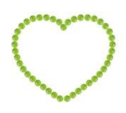 Множество зеленых пилюлек сформировало в форме сердца Стоковые Изображения RF