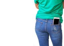 Мобильный телефон в брюках джинсов Стоковая Фотография RF