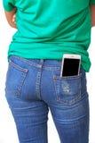 Мобильный телефон в брюках джинсов Стоковое фото RF