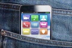 Мобильный телефон в карманн Стоковые Изображения