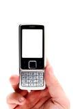 мобильный телефон мужчины удерживания руки Стоковые Изображения RF