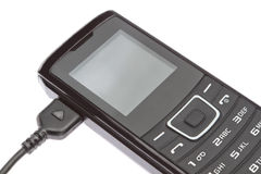 Мобильный телефон пока поручающ. Стоковые Изображения RF