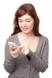 мобильный телефон посылая женщине sms Стоковая Фотография