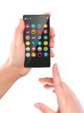 Мобильный телефон владением руки с красочными значками применения Стоковое Изображение