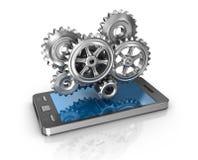Мобильный телефон и шестерни Принципиальная схема разработки приложений Стоковая Фотография