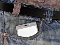 Мобильный телефон, мобильный телефон в карманных голубых джинсах Стоковые Изображения