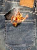 Мобильный телефон на огне Стоковое Изображение